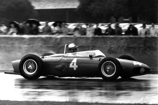 1961-gp-de-gran-bretac3b1a-wolfgang-von-trips-guiding-the-ferrari-dino-156-f1-to-victory-in-the-wet-at-aintree